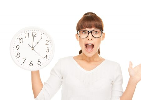 bigstock_Woman_Holding_Big_Clock_9045409